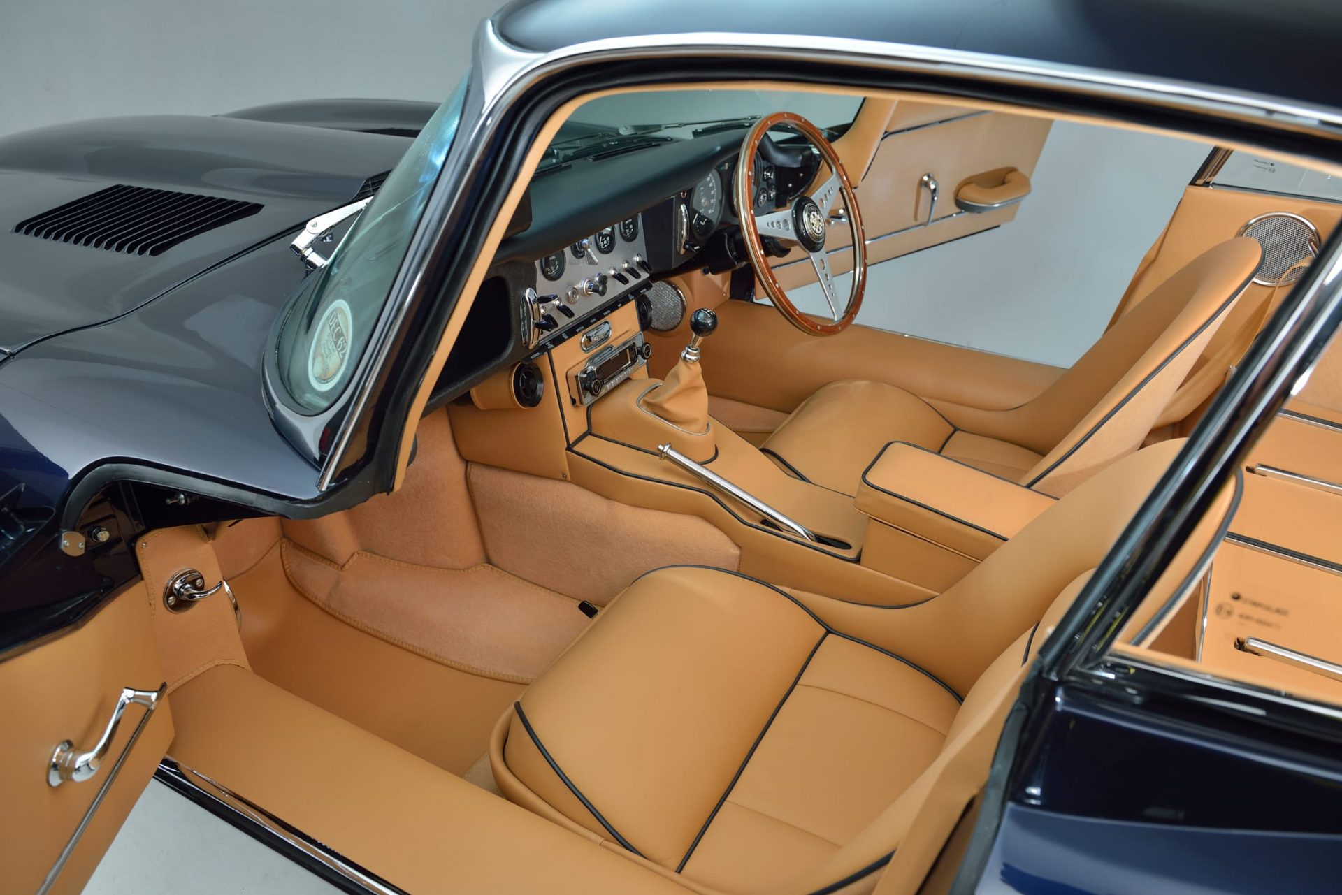 Tan interior trim and tan leather seats of Jaguar E Type S1 3.8 1962