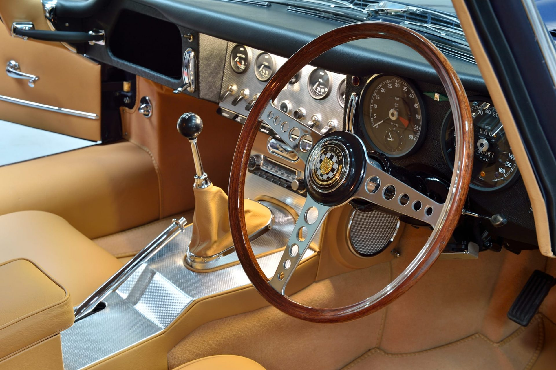 Tan interior, leather seats and steering wheel of Jaguar E Type S1 3.8 1964