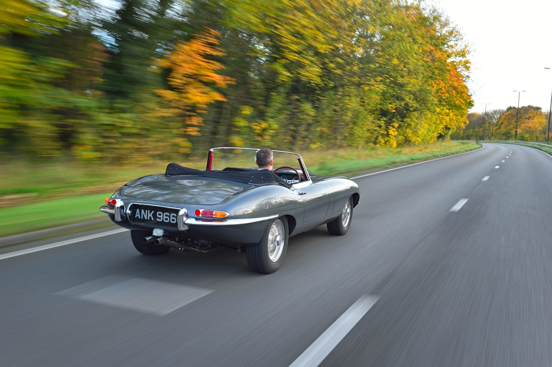 Jaguar classic car driving on the road