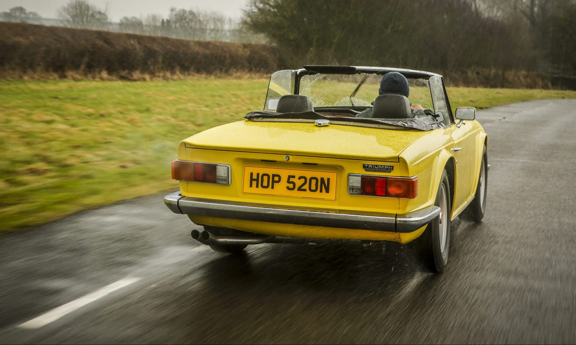 Rear view of yellow Triumph