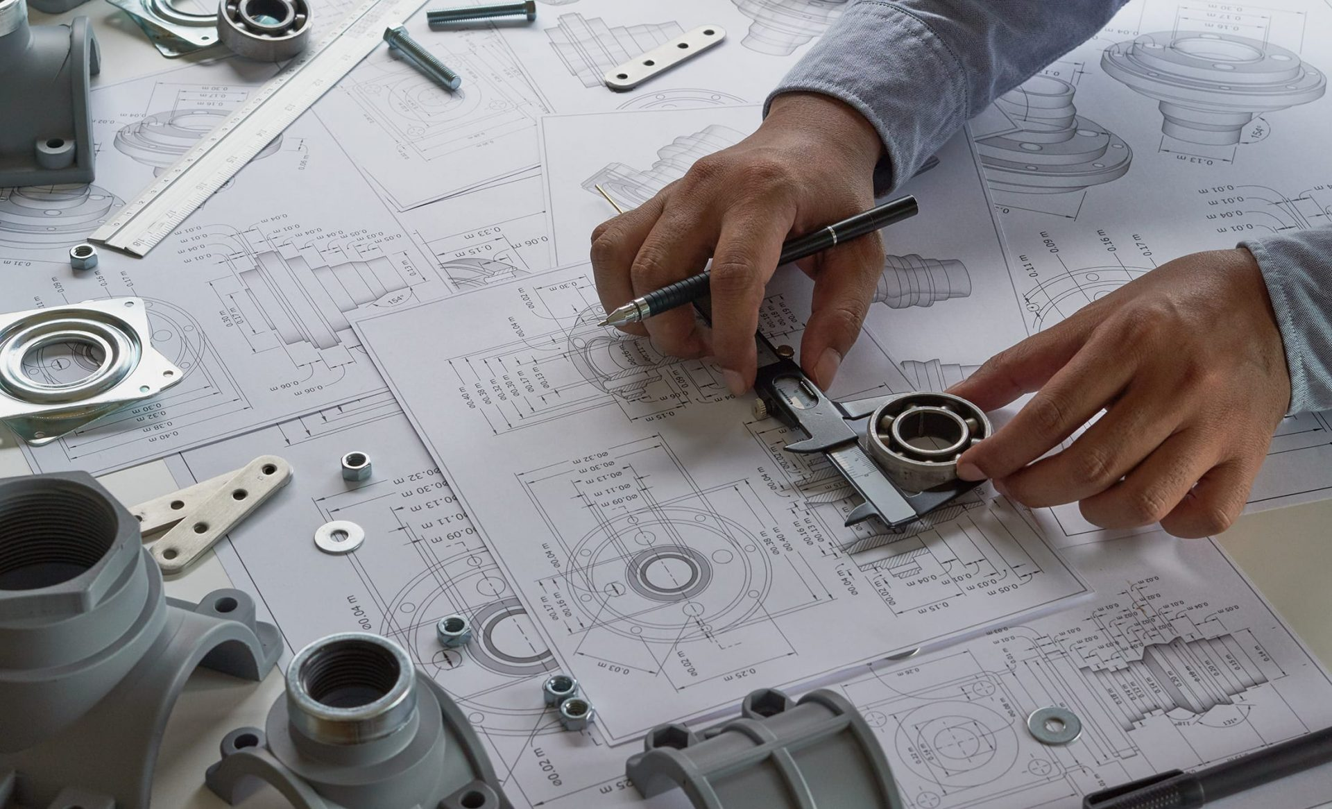 Engineers with technical drawings